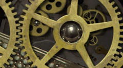 The internal gears and moving parts mechanism of an antique clock Stock Footage