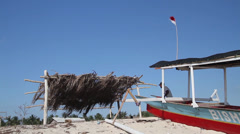 Canopy and a boat at the beach Stock Footage
