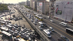Traffic jam on Istanbul highway, afternoon rush hour, office towers, business Stock Footage