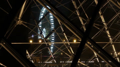 Louvre museum pyramids see-through amusement-park-night Stock Footage