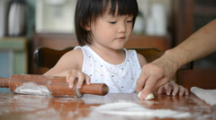 Little girl playing with dough Stock Footage
