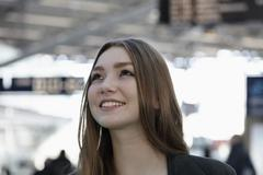 Germany, Cologne, Young woman at airport, smiling Stock Photos