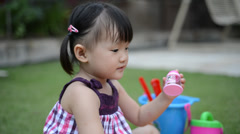 Little girl play in the garden Stock Footage