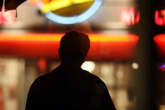 Silhouette over neon lights Stock Photos