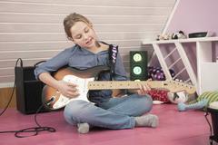 Girl playing guitar - stock photo