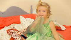 Little girl under covers playing Stock Footage