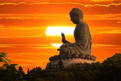 buddha at sunset - stock photo