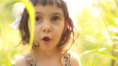 Baby girl portrait in grass. Stock Footage