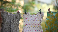 Young adult woman collects laundry. Stock Footage