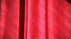 young adult woman sees something outdoor and draws drapes. - stock footage