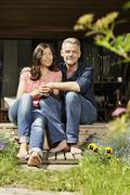 Stock Photo of Germany, Berlin, Mature couple relaxing on terrace, smiling, portrait