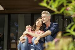 Stock Photo of Germany, Berlin, Mature couple relaxing on terrace