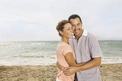 Stock Photo of Spain, Mid adult couple on beach at Palma de Mallorca, smiling