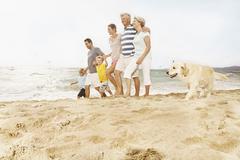 Spain, Family walking on beach at Palma de Mallorca Stock Photos