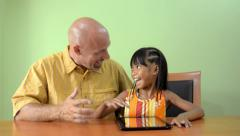 A Father Congratulates His Daughter After Winning iPad Game Stock Footage
