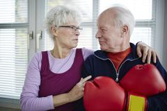 Germany, Duesseldorf, Senior couple with boxing glove, smiling Stock Photos