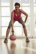 Germany, Duesseldorf, Mature woman exercising with kettlebell Stock Photos