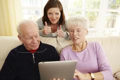 Germany, Duesseldorf, Man and women using digital tablet - stock photo