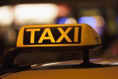 Stock Photo of Germany, Bavaria, Munich, Illuminated sign on taxi showing availability