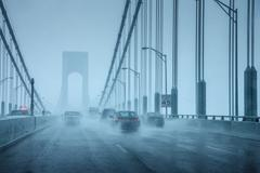Cars driving in rainy weather Stock Photos