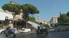 Scooters, buses & fire engines in Rome (slomo dolly) Stock Footage