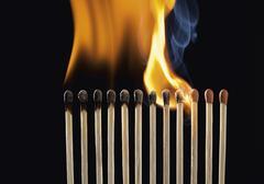 Burning matchsticks against black background, close up Stock Photos