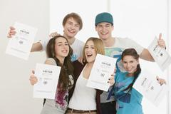 Stock Photo of Young people with High School Diploma, smiling, portrait