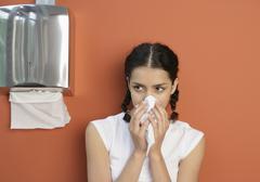 Young woman sneezing, close up Stock Photos