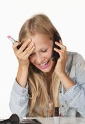 Teenage girl talking on mobile phone, smiling - stock photo