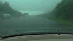 Pouring Rain on Car Windshield While Driving Stock Footage