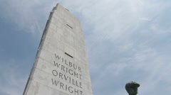 Orville Wright Statue in front of Memorial Stock Footage