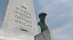 Orville Wright Bust in front of Memorial Pan shot Stock Footage