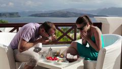 Couple eating  tasteless cupcake on beautiful terrace HD Stock Footage