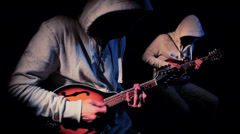 2 Mysterious Hooded Musicians Playing Mandolin in the Shadows HD 3 Stock Footage