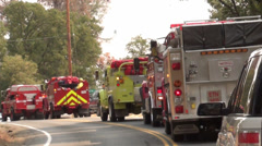 Fire, Police, Emergency Row of Fire Trucks Driving 1 Stock Footage