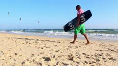 Kite Surf QDL D1 (Kiteboarder walking by in scene) - stock footage