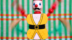 Colorful wooden puppets dancing Stock Footage