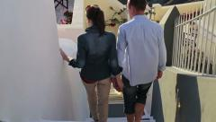 Tourist couple during sightseeing on Santorini HD - stock footage