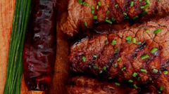 Grilled beef meat on wooden plate Stock Footage