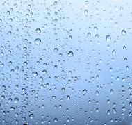 Waterdrops on a glass Stock Photos