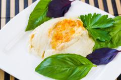 Baked stuffed sole fish with herbs on side Stock Photos