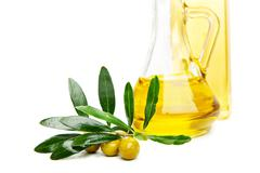 Olive oil and branch with olives on white Stock Photos