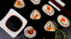 Sushi Maki Roll on black plate Stock Footage