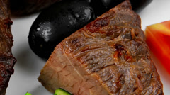 Meat food : roast beef fillet mignon served on white over black Stock Footage