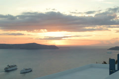 Cruise ships by the Santorini island during sunset NTSC Stock Footage