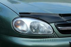 Fragment of a car. the right front headlight Stock Photos