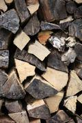 stockpile of chopped wood - stock photo