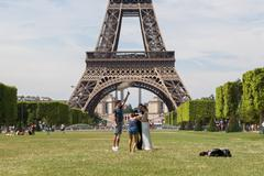 Stock Photo of paris - july 27: newly wed couple at the eiffel tower on july 27, 2013, in pa