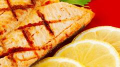Salmon steak on red Stock Footage