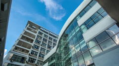 Low angle shot of modern office building with glass wall. Stock Footage